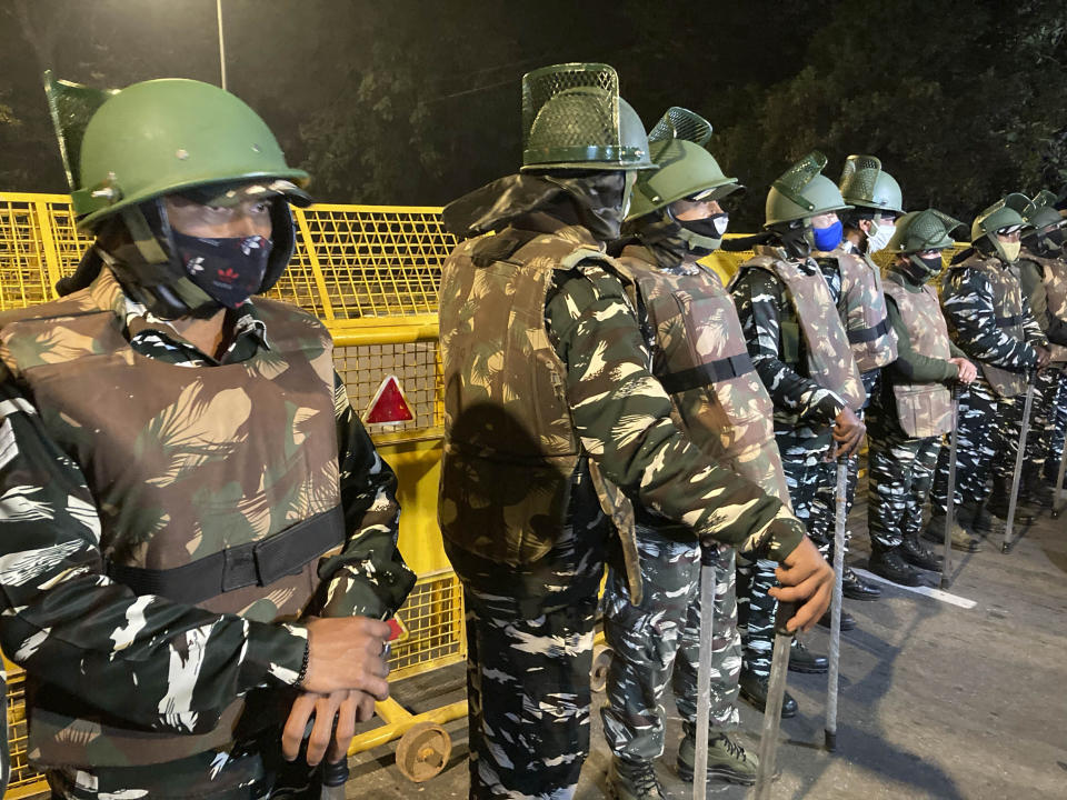 """Policemen stand guard near the Israeli Embassy after a blast in the area in New Delhi, India, Friday, Jan. 29, 2021. A """"very low intensity"""" device exploded Friday near the Israeli Embassy in the Indian capital, but there were no injuries and little damage, police said. (AP Photo/Rishi Lekhi)"""