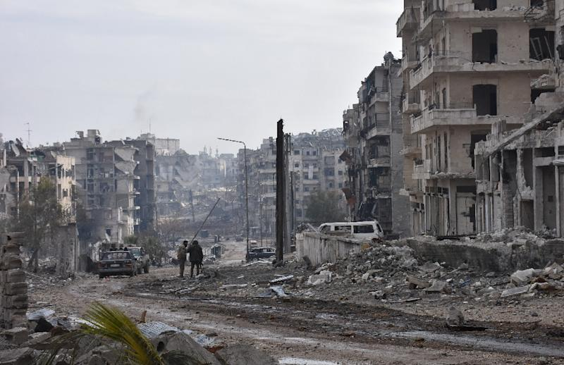 Syrian troops cemented their hold on Aleppo after retaking full control of the city, as residents anxious to return to their homes moved through its ruined streets (AFP Photo/George Ourfalian)