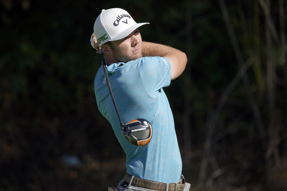Sam Burns tees off on the 13th hole during the first round of the Genesis Invitational golf tournament at Riviera Country Club, Thursday, Feb. 18, 2021, in the Pacific Palisades area of Los Angeles. (AP Photo/Ryan Kang)