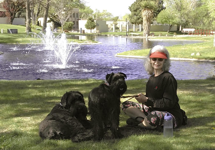 Penny Wagner appears with her two dogs, Clarence, left, and Cooper in Albuquerque, N.M., on April 8, 2020. Clarence died peacefully March 9 after Wagner and her husband hired a private service that provides home euthanasia for pets. (Steve Wagner via AP)