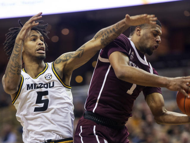 Texas A&M's Savion Flagg, right, pulls down a rebound in front of Missouri's Mitchell Smith, left, during the first half of an NCAA college basketball game, Saturday, Feb. 9, 2019, in Columbia, Mo. (AP Photo/L.G. Patterson)