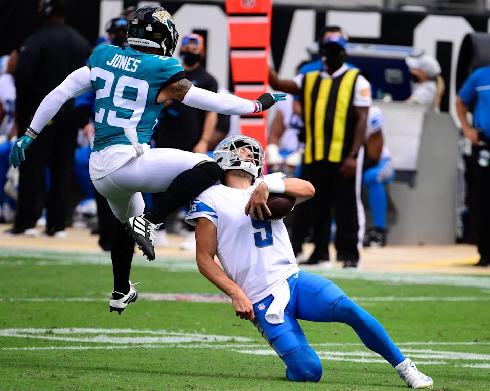 Detroit Lions quarterback Matthew Stafford scrambles with the ball against Jacksonville Jaguars safety Josh Jones during the first half at TIAA Bank Field, Oct. 18, 2020.