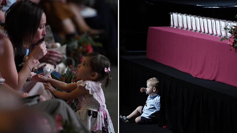 Pictrued left is Melissa O'Dwyer kissing a photo of her husband Andrew O'Dwyer with daughter Charlotte. Right, Harvey Keaton, son of Geoffrey Keaton, sits in front of the stage. Source: AAP