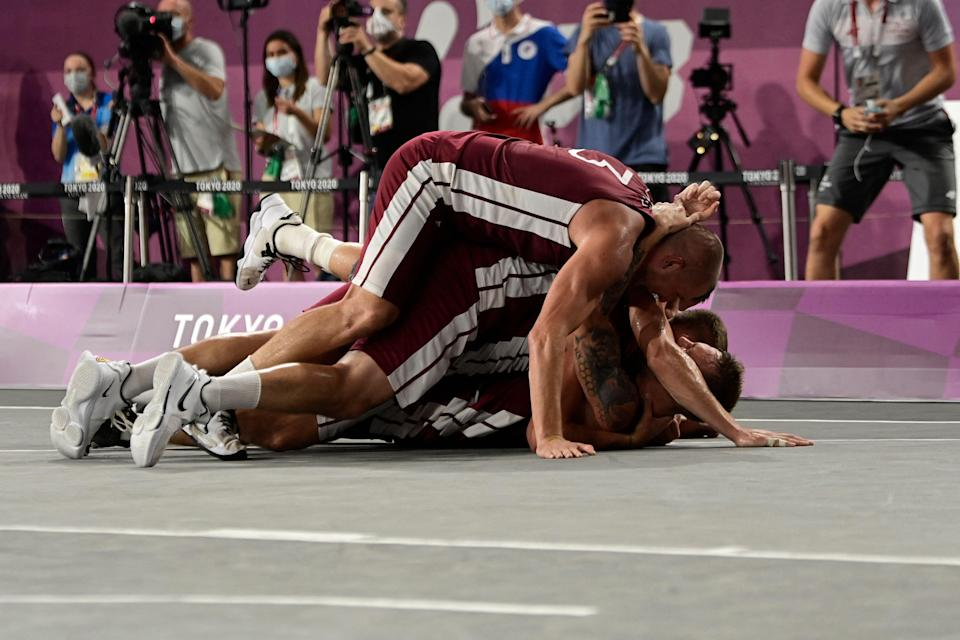 Latvia celebrate their dramatic gold-winning performance in the men's 3x3 final (AFP/Getty)