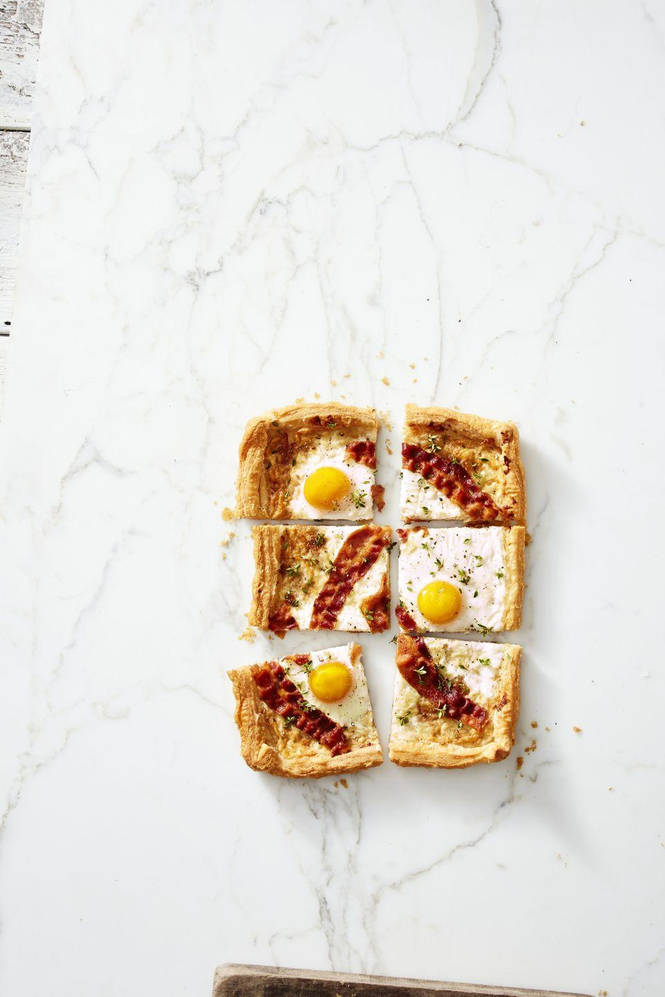 """<p>Use eggs and bacon as decoration for this """"pizza pie.""""</p><p><a class=""""link rapid-noclick-resp"""" href=""""https://www.amazon.com/gp/product/B019S3W8AO/ref=s9_acsd_topr_hd_bw_b1DO9_c_x_1_w?tag=syn-yahoo-20&ascsubtag=%5Bartid%7C10055.g.1914%5Bsrc%7Cyahoo-us"""" rel=""""nofollow noopener"""" target=""""_blank"""" data-ylk=""""slk:SHOP PIZZA CUTTERS"""">SHOP PIZZA CUTTERS</a></p><p><em><a href=""""https://www.goodhousekeeping.com/food-recipes/easy/a42425/bacon-gruyere-breakfast-pie-recipe/"""" rel=""""nofollow noopener"""" target=""""_blank"""" data-ylk=""""slk:Get the recipe for Bacon Gruyére Breakfast &quot;Pie&quot; »"""" class=""""link rapid-noclick-resp"""">Get the recipe for Bacon Gruyére Breakfast """"Pie"""" »</a></em></p>"""