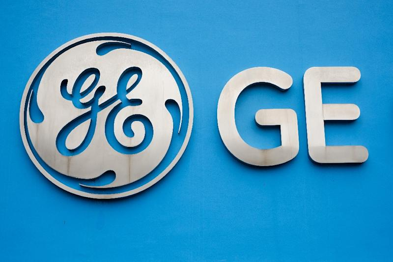General Electric reported a $1.2 billion loss in the first quarter following a large legal charge, but shares surged after operating profits topped analyst expectations