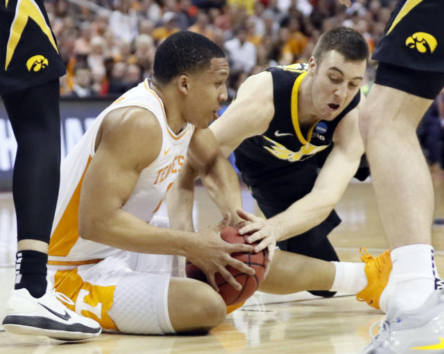 Tennessee's Grant Williams, left, and Iowa's Connor McCaffery battle for the ball in the first half during a second-round men's college basketball game in the NCAA Tournament in Columbus, Ohio, Sunday, March 24, 2019. (AP Photo/John Minchillo)