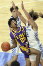 LSU's Eric Gaines (25) collides with Kentucky's Devin Askew (2) during the first half of an NCAA college basketball game in Lexington, Ky., Saturday, Jan. 23, 2021. (AP Photo/James Crisp)