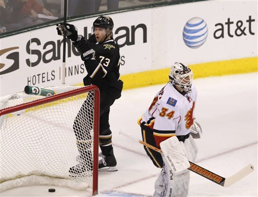 Dallas Stars right wing Michael Ryder (73) celebrates his goal against Calgary Flames goalie Miikka Kiprusoff (34) of Finlamd during the first period of an NHL hockey game in Dallas, Saturday, March 24, 2012. (AP Photo/LM Otero)