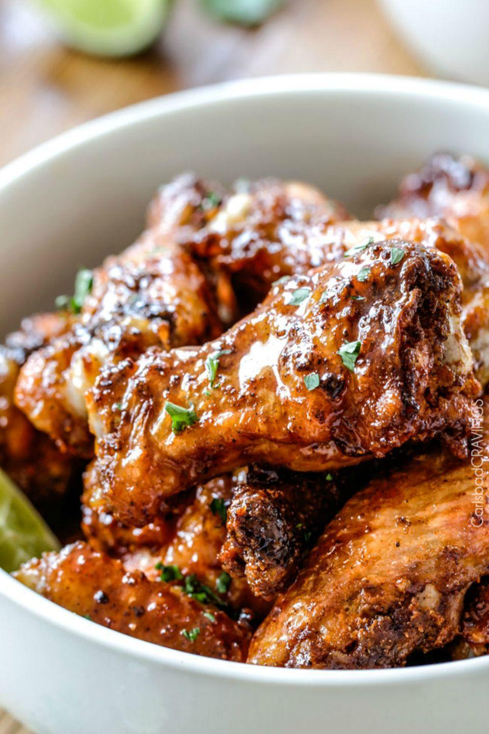 "<p>We recommend making an extra batch of these sticky but oh-so-good honey lime wings, because they're gonna go fast.</p><p><strong>Get the recipe <a href=""http://carlsbadcravings.com/baked-chipotle-honey-lime-hot-wings-recipe/"" rel=""nofollow noopener"" target=""_blank"" data-ylk=""slk:Carlsbad Cravings"" class=""link rapid-noclick-resp"">Carlsbad Cravings</a>. </strong></p>"
