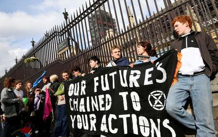 FILE PHOTO: Climate change activists lock themselves at the gate of the Houses of Parliament during an Extinction Rebellion protest in London, Britain May 3, 2019. REUTERS/Toby Melville