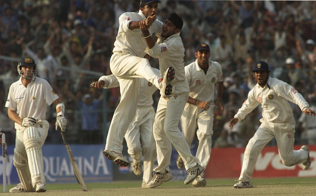 15 Mar 2001:  Saurav Ganguly captain of India jumps into team mate Harbhajan Singh's arms as Singh traps Glenn McGrath of Australia LBW to win the test, during day five of the 2nd Test between India and Australia played at Eden Gardens, Calcutta, India.X DIGITAL IMAGE  Mandatory Credit: Hamish Blair/ALLSPORT