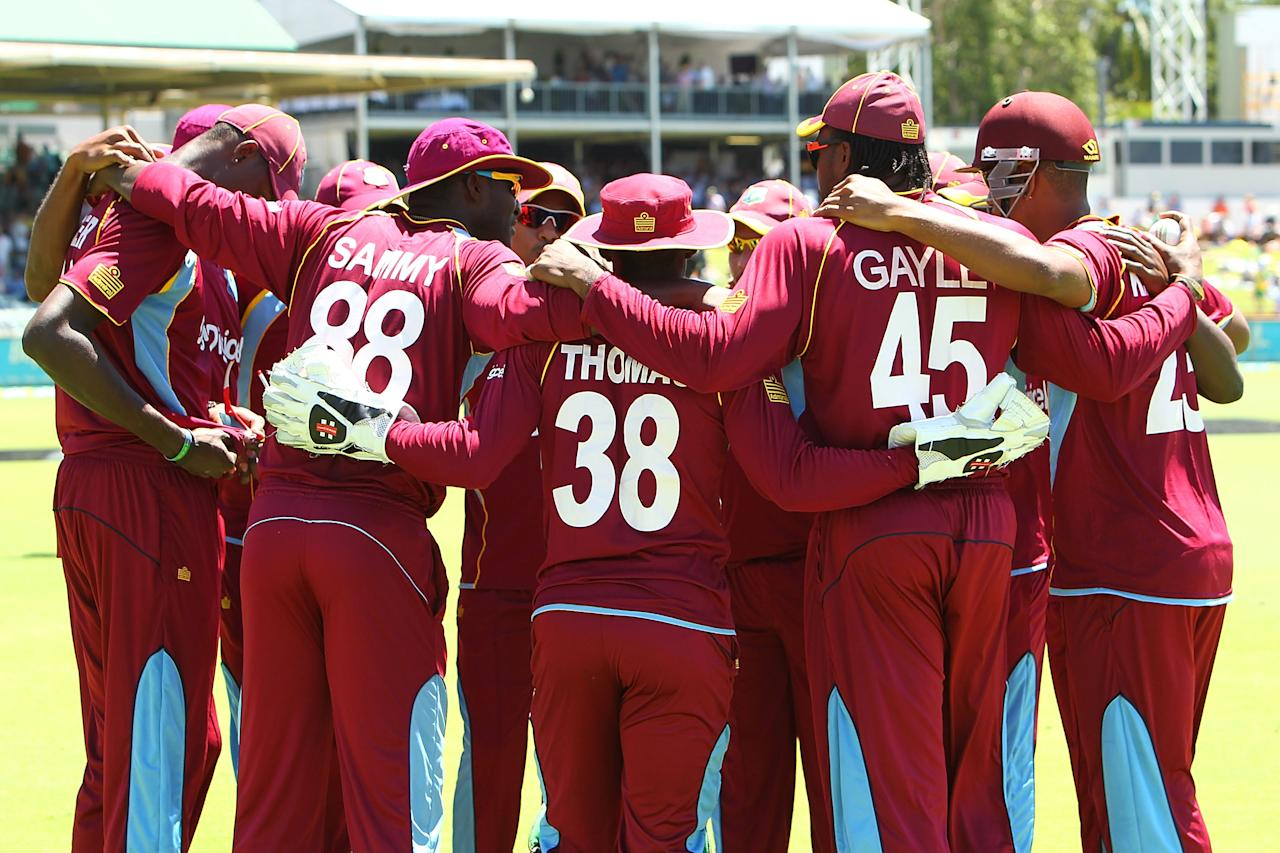 PERTH, AUSTRALIA - FEBRUARY 01: The West Indies team huddle at the start of game one of the Commonwealth Bank One Day International Series between Australia and the West Indies at WACA on February 1, 2013 in Perth, Australia.  (Photo by Will Russell/Getty Images)