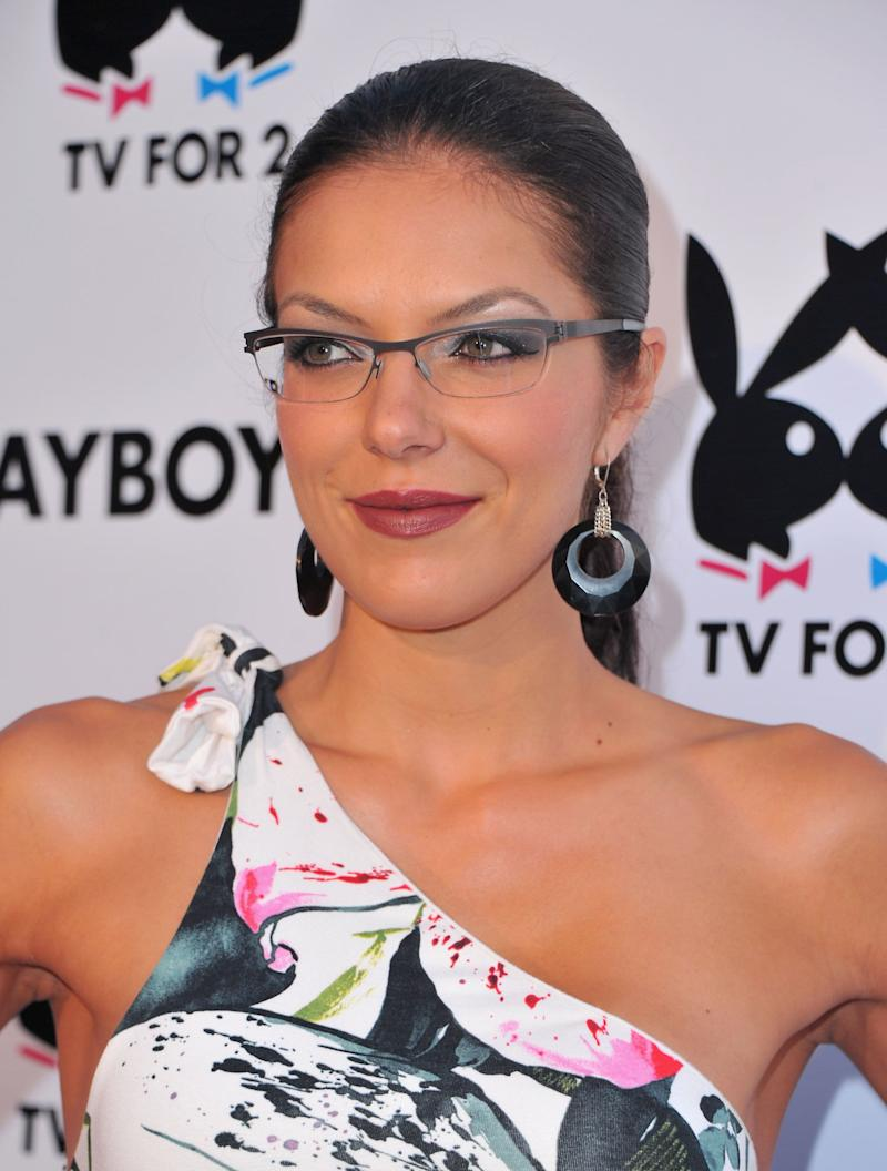 Adrianne Curry looks breath-taking in this multi-colored dress, nerdy look.