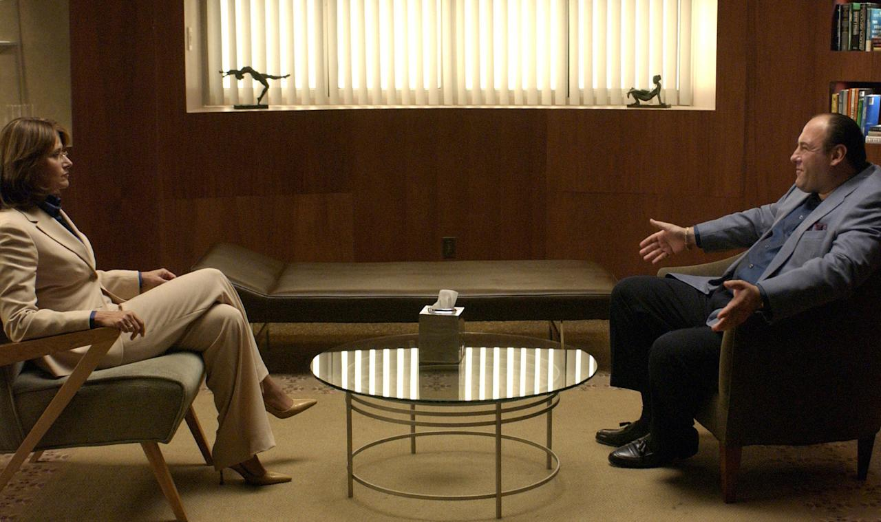 """FILE - This undated file photo provided by HBO shows James Gandolfini, as Tony Soprano, right, and Lorraine Bracco, as Dr. Jennifer Melfi, from a scene from the fourth season of """"The Sopranos."""" HBO and the managers for Gandolfini say the actor died Wednesday, June 19, 2013, in Italy. He was 51. (AP Photo/HBO, File)"""
