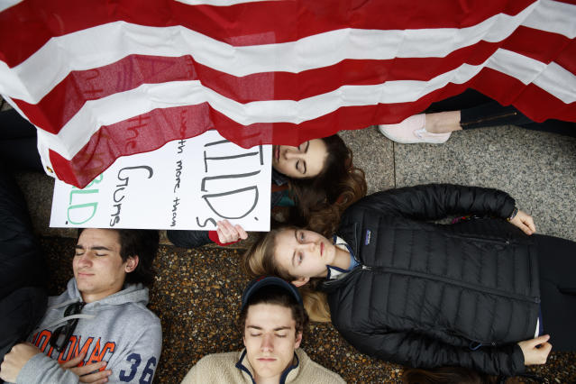 "<p>Anna Hurley, 15, of Washington, top, and other demonstrators participate in a ""lie-in"" during a protest in favor of gun control reform in front of the White House, Monday, Feb. 19, 2018, in Washington. (Photo: Evan Vucci/AP) </p>"