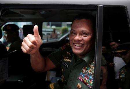 FILE PHOTO: Indonesia's Armed Forces Commander General Gatot Nurmantyo gestures as he sits inside his vehicle after talking to reporters in Jakarta