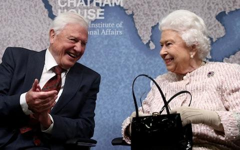 David Attenborough sits next to Britain's Queen Elizabeth during the annual Chatham House award in London on Wednesday  - Credit: Simon Dawson /Reuters