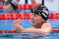 <p>Katie Ledecky cries after winning the final of the women's 1500m freestyle swimming event during the Tokyo 2020 Olympic Games at the Tokyo Aquatics Centre in Tokyo on July 28, 2021. (Photo by Jonathan NACKSTRAND / AFP)</p>