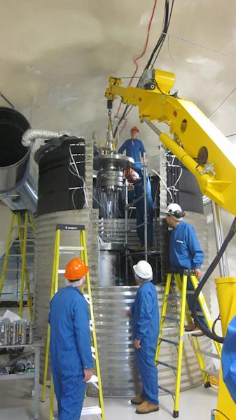 Scientists install the COUPP-60 detector a mile and a half underground at SNOLAB in Ontario, Canada.