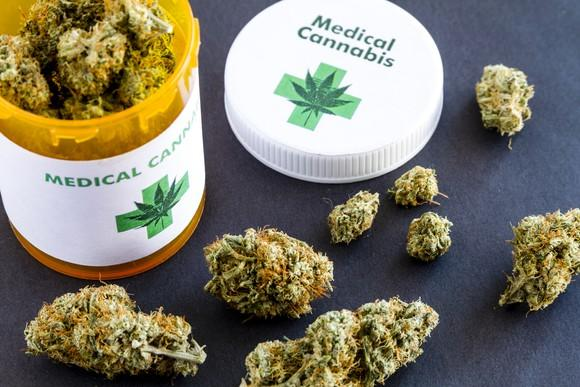 A prescription bottle filled with marijuana buds.