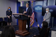 Special Presidential Envoy for Climate John Kerry speaks during a press briefing at the White House, Wednesday, Jan. 27, 2021, in Washington. National Climate Adviser Gina McCarthy, right, and Press Secretary Jen Psaki listen. (AP Photo/Evan Vucci)
