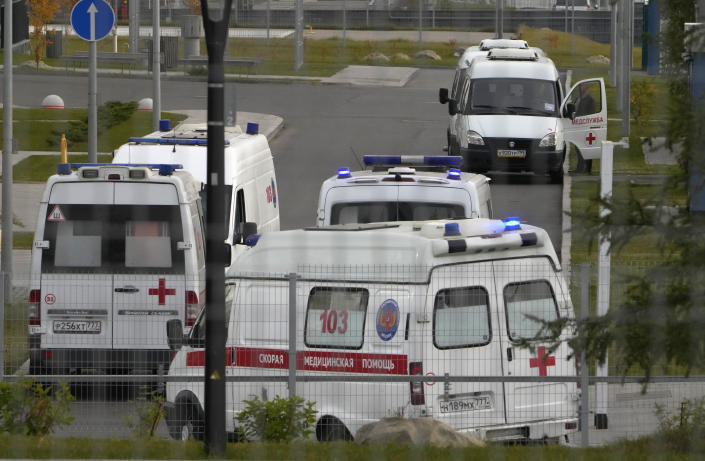 Ambulances stand in line to deliver patients suspected of having coronavirus to a hospital in Kommunarka, outside Moscow, Russia, Tuesday, Oct. 12, 2021. Russia hit another record of daily coronavirus deaths Tuesday as the country struggled with a rapid surge of infections and lagging vaccination rates, but authorities have been adamant that there would be no new national lockdown. (AP Photo/Alexander Zemlianichenko)