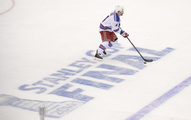 New York Rangers defenseman Raphael Diaz skates past the Stanley Cup logo during the first period in Game 1 of the NHL hockey Stanley Cup Finals against the Los Angeles Kings, Wednesday, June 4, 2014, in Los Angeles. (AP Photo/Mark J. Terrill)