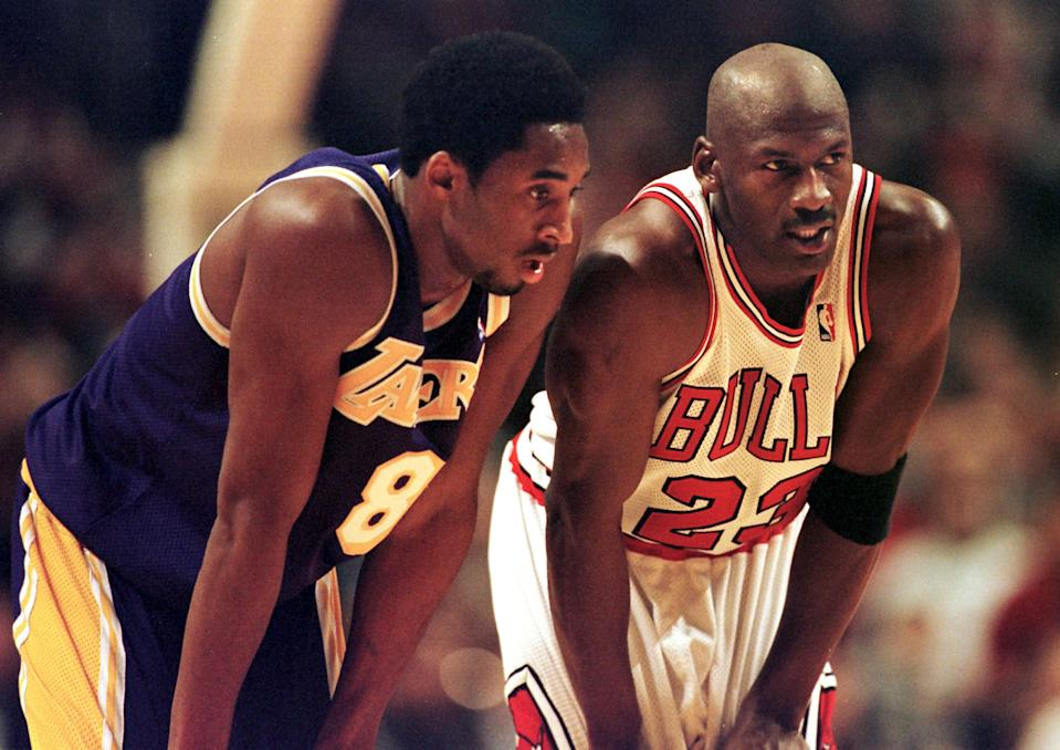 Los Angeles Lakers guard Kobe Bryant(L) and Chicago Bulls guard Michael Jordan(R) talk during a free-throw attempt during the fourth quarter 17 December at the United Center in Chicago. Bryant, who is 19 and bypassed college basketball to play in the NBA, scored a team-high 33 points off the bench, and Jordan scored a team-high 36 points. The Bulls defeated the Lakers 104-83.  AFP PHOTO  VINCENT LAFORET (Photo by VINCENT LAFORET / AFP)        (Photo credit should read VINCENT LAFORET/AFP via Getty Images)