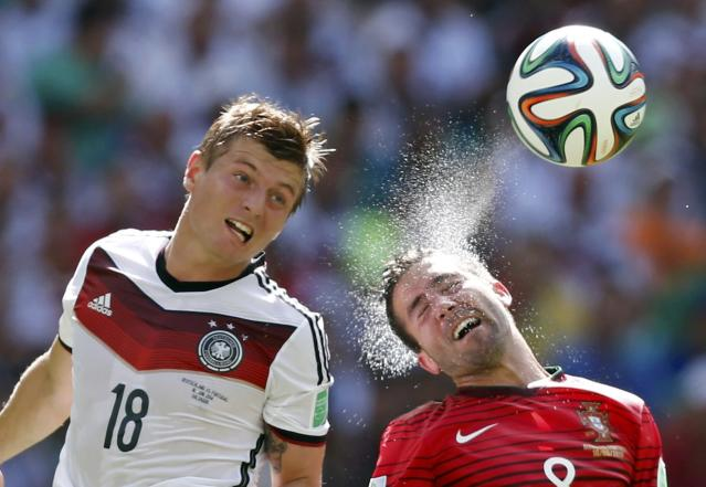 Germany's Toni Kroos (L) and Portugal's Joao Moutinho fight for the ball during their 2014 World Cup Group G soccer match at the Fonte Nova arena in Salvador June 16, 2014. REUTERS/Marcos Brindicci (BRAZIL - Tags: SOCCER SPORT WORLD CUP)