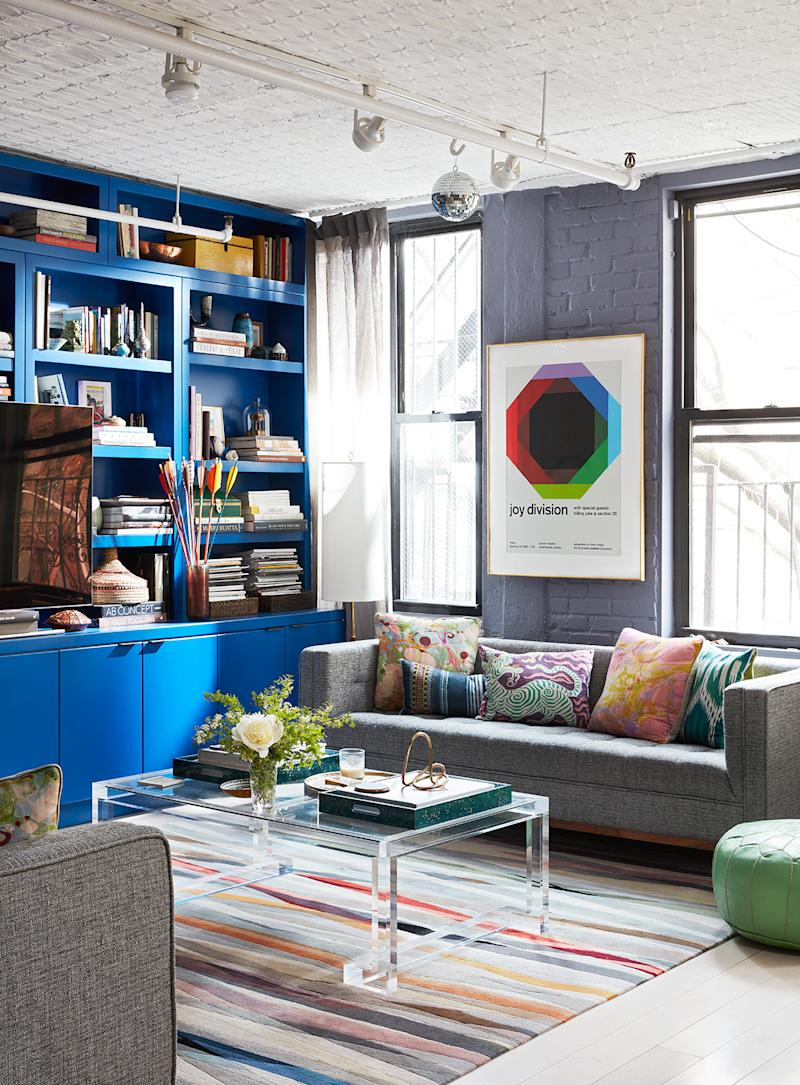modern blue living space with track lighting