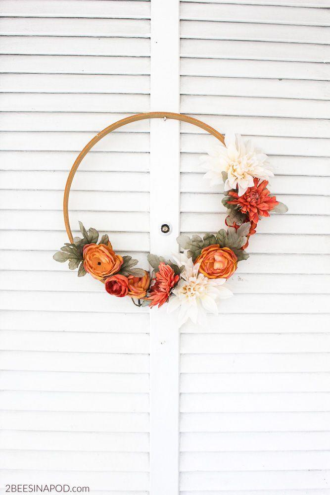 """<p>Make this elegant DIY your own by using a variety of blooms in autumnal colors that will complement your fall decor.</p><p><strong>Get the tutorial at <a href=""""https://2beesinapod.com/2017/08/16/fall-embroidery-hoop-wreath/"""" rel=""""nofollow noopener"""" target=""""_blank"""" data-ylk=""""slk:2 Bees in a Pod"""" class=""""link rapid-noclick-resp"""">2 Bees in a Pod</a>.</strong> </p>"""