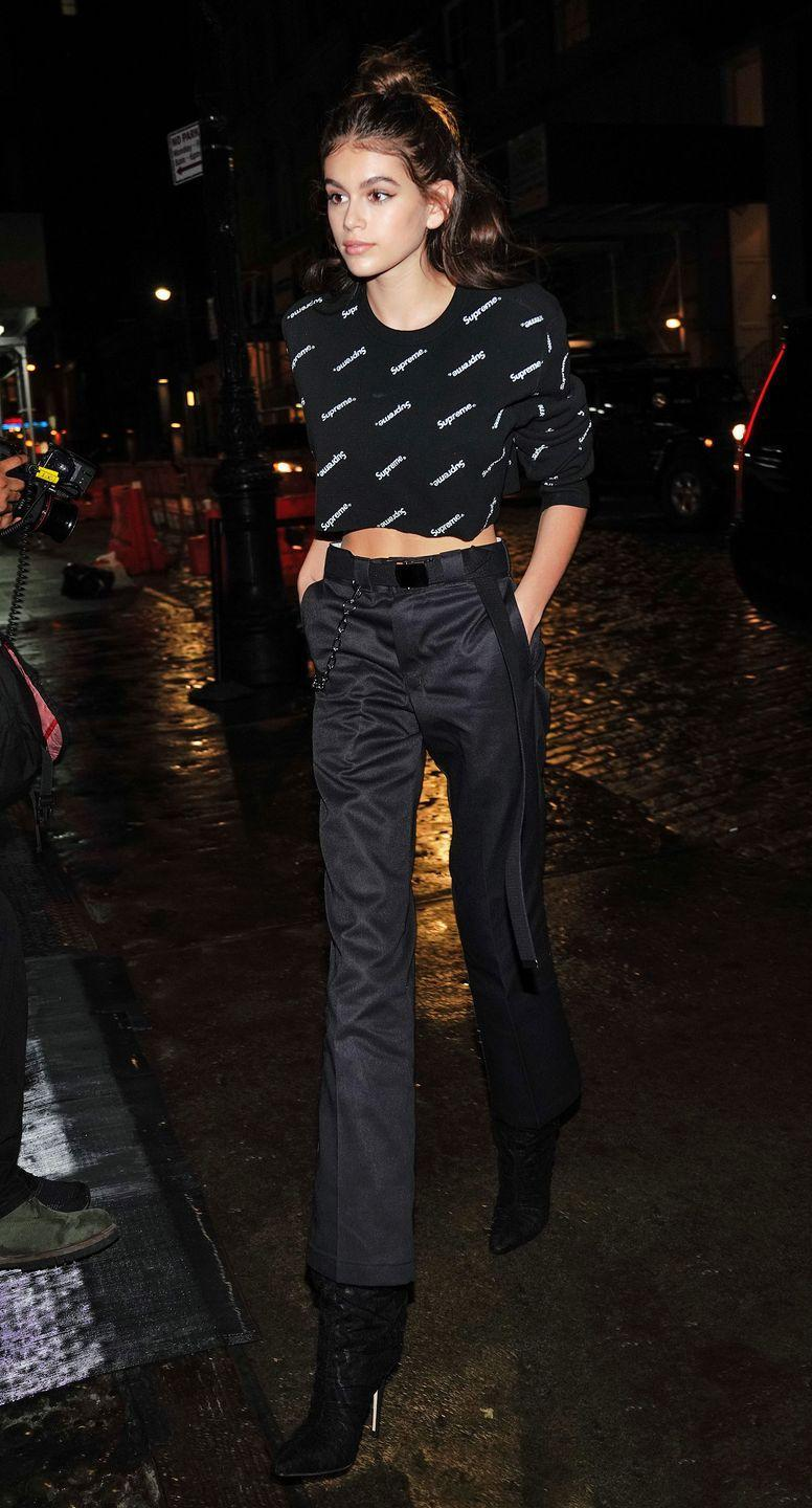 <p>The 16-year-old wore high-waisted bootcut jeans and a cropped T-shirt while running errands in New York </p>