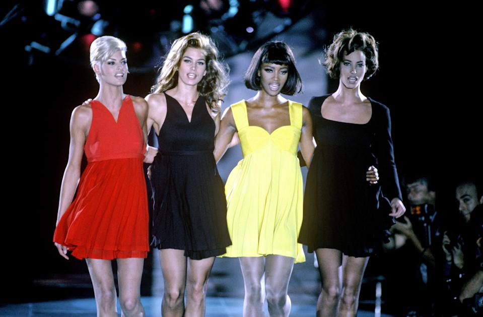 """<p class=""""body-dropcap"""">""""Enter the Era of Elegance,"""" read the cover line of <em>Harper's BAZAAR</em>'s September 1992 issue, and it was models who represented this credo. From '80s powerhouses like Linda Evangelista, Naomi Campbell, and Cindy Crawford to newcomers like Kate Moss, Alek Wek, and Jenny Shimizu, these diverse beauties superseded the close, esoteric confines, stepping off the runway and onto the global stage. </p><p>A quote from Evangelista describes their ascendancy best. """"We don't wake up for less than $10,000 a day,"""" she famously <a href=""""https://www.crfashionbook.com/celebrity/a27409908/linda-evangelista-quote-10000-a-day/"""" rel=""""nofollow noopener"""" target=""""_blank"""" data-ylk=""""slk:quipped in 1990"""" class=""""link rapid-noclick-resp"""">quipped in 1990</a>. Ahead, we've rounded up the top names that made bank, attracted headlines, and fully exemplified '90s supermodels with a capital <em>S</em>.</p>"""