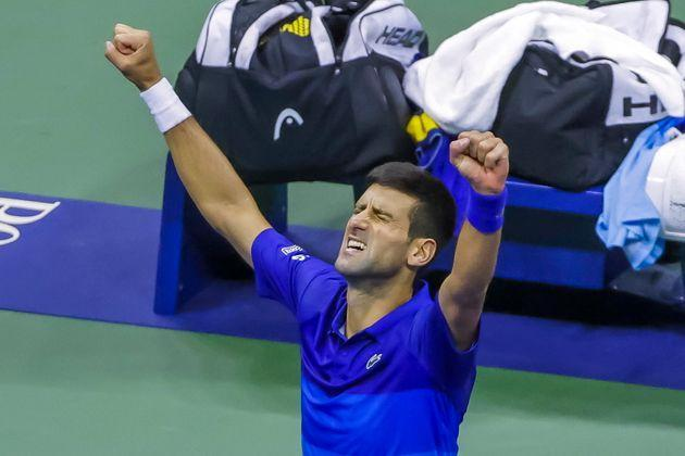 epa09460564 Novak Djokovic of Serbia reacts after defeating Alexander Zverev of Germany in a men's singles semifinal round match on the twelfth day of the US Open Tennis Championships at the USTA National Tennis Center in Flushing Meadows, New York, USA, 10 September 2021. The US Open runs from 30 August through 12 September.  EPA/JASON SZENES (Photo: JASON SZENESEPA)
