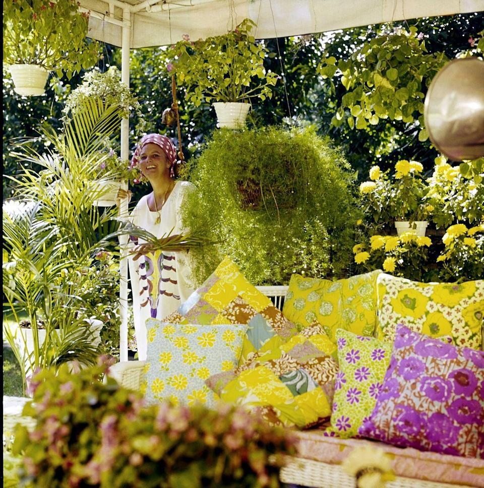 <p>Lilly Pulitzer's Palm Beach patio was just as colorful as you'd expect. The designer's outdoor sofa in the '70s was covered in pillows cut from her vibrant designs.</p>