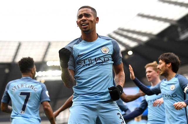 <p>Gabriel Jesus of Manchester City celebrates scoring his sides first goal during the Premier League match between Manchester City and Swansea City at Etihad Stadium on February 5, 2017 in Manchester, England </p>