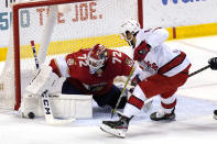 Florida Panthers goaltender Sergei Bobrovsky (72) stops a shot goal by Carolina Hurricanes center Vincent Trocheck (16) during the second period of an NHL hockey game Thursday, April 22, 2021, in Sunrise, Fla. (AP Photo/Marta Lavandier)