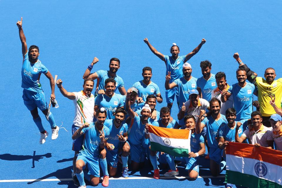 <p>Varun Kumar (L) of Team India reacts with the team after winning the Men's Bronze medal match between Germany and India on day thirteen of the Tokyo 2020 Olympic Games at Oi Hockey Stadium on August 05, 2021 in Tokyo, Japan. (Photo by Alexander Hassenstein/Getty Images)</p>
