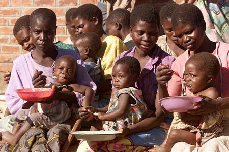 MALNOURISHED MALAWIAN CHILREN ARE FED BY THEIR MOTHERS.