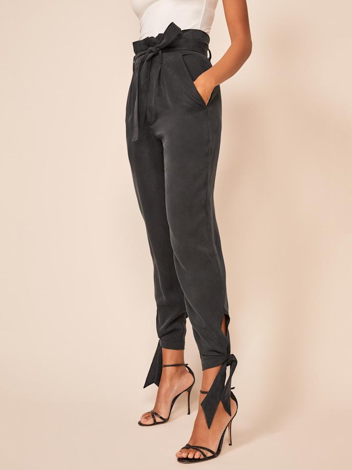 "<p>The ankle ties on these <a href=""https://www.popsugar.com/buy/Reformation-Avalon-Pants-494120?p_name=Reformation%20Avalon%20Pants&retailer=thereformation.com&pid=494120&price=178&evar1=fab%3Aus&evar9=46676606&evar98=https%3A%2F%2Fwww.popsugar.com%2Ffashion%2Fphoto-gallery%2F46676606%2Fimage%2F46676608%2FReformation-Avalon-Pants&list1=shopping%2Cfall%2Cpants%2Cfall%20shopping%2Ccomfortable%20clothes&prop13=api&pdata=1"" rel=""nofollow"" data-shoppable-link=""1"" target=""_blank"" class=""ga-track"" data-ga-category=""Related"" data-ga-label=""https://www.thereformation.com/products/avalon-pant?color=Black&amp;via=Z2lkOi8vcmVmb3JtYXRpb24td2VibGluYy9Xb3JrYXJlYTo6Q2F0YWxvZzo6Q2F0ZWdvcnkvNWE2YWRmZDNmOTJlYTExNmNmMDRlOWNh&amp;new=true"" data-ga-action=""In-Line Links"">Reformation Avalon Pants</a> ($178) are perfect.</p>"