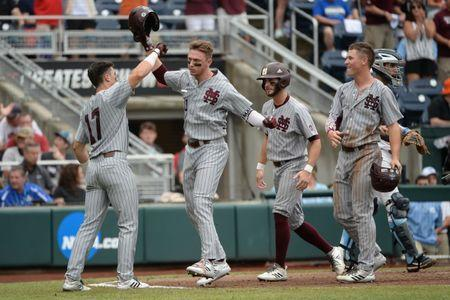 Jun 19, 2018; Omaha, NE, USA; Mississippi State Bulldogs designated hitter Jordan Westburg (11) celebrates a grand slam with third baseman Justin Foscue (17) and right fielder Elijah MacNamee (40) and shortstop Luke Alexander (7) in the second inning against the North Carolina Tar Heels in the College World Series at TD Ameritrade Park. Mandatory Credit: Steven Branscombe-USA TODAY Sports