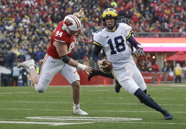 "Michigan quarterback <a class=""link rapid-noclick-resp"" href=""/ncaaf/players/263464/"" data-ylk=""slk:Brandon Peters"">Brandon Peters</a> runs past Wisconsin's <a class=""link rapid-noclick-resp"" href=""/ncaaf/players/255392/"" data-ylk=""slk:Chris Orr"">Chris Orr</a> during the first half of an NCAA college football game Saturday, Nov. 18, 2017, in Madison, Wis. (AP Photo/Morry Gash)"
