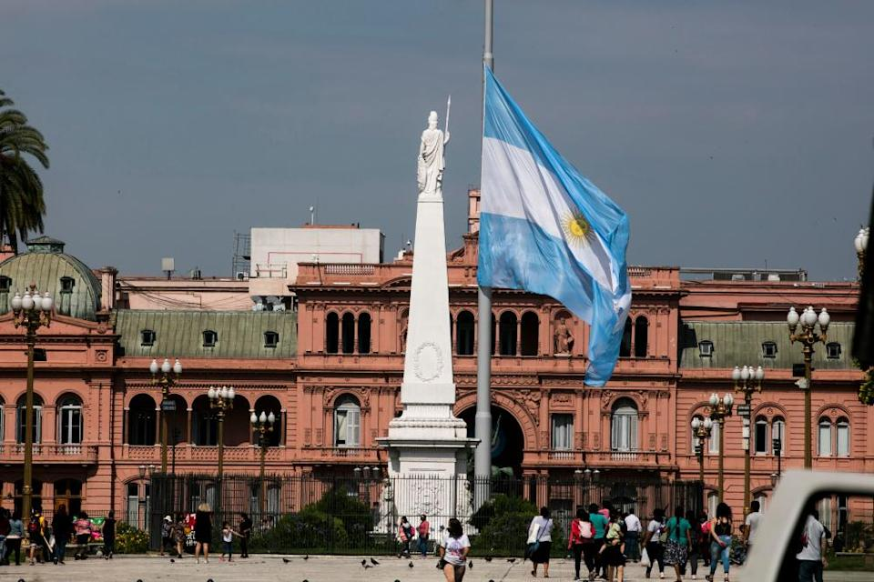 An Argentine flag flies at half mast on Plaza de Mayo in front of Casa Rosada in tribute to Diego Maradona.