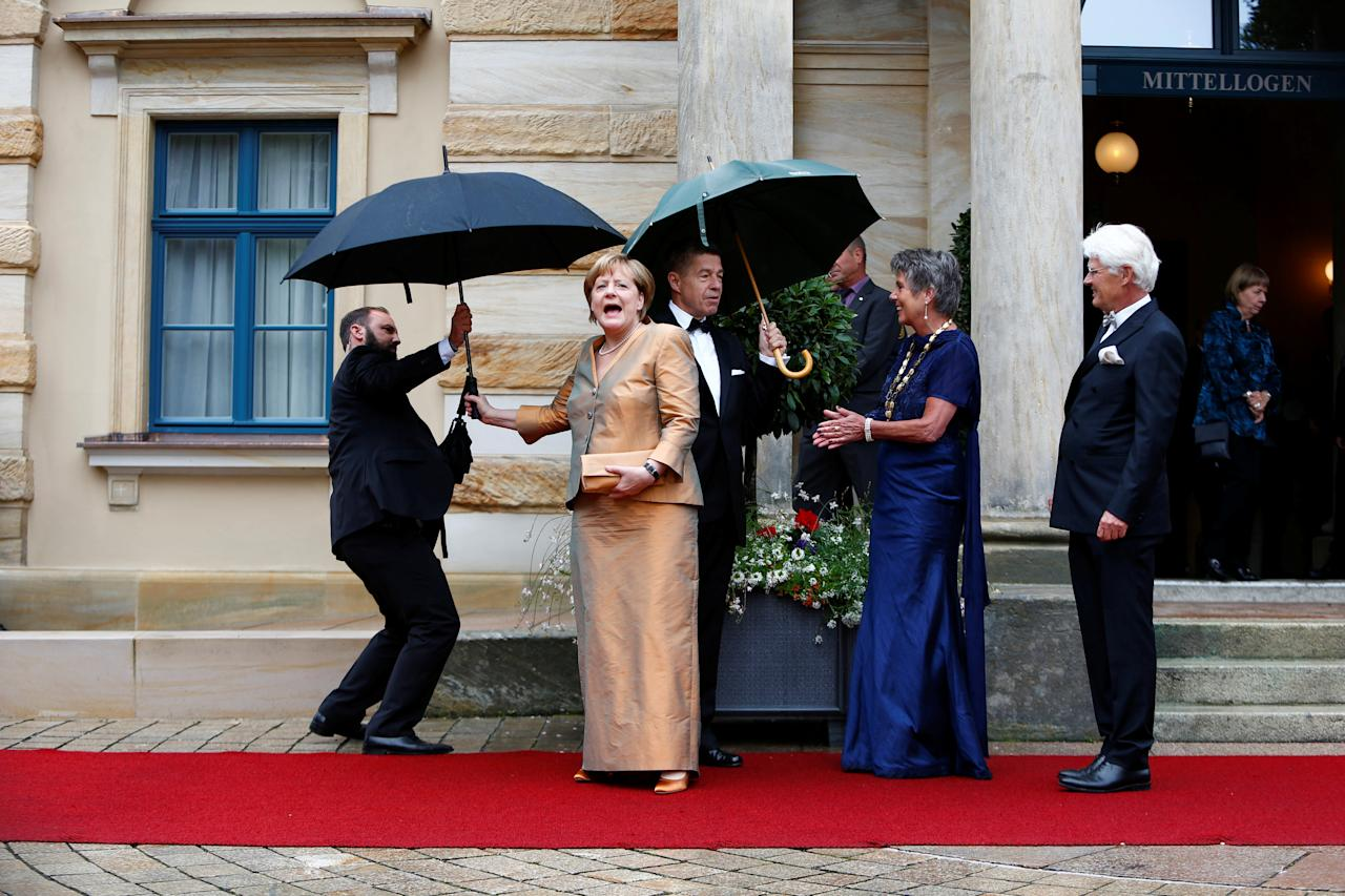 German Chancellor Angela Merkel reacts as she arrives at the red carpet for the opening of the Bayreuth Wagner opera festival outside the Gruener Huegel (Green Hill) opera house in Bayreuth, Germany July 25, 2017. REUTERS/Michaela Rehle     TPX IMAGES OF THE DAY