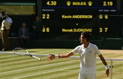 He's back: Novak Djokovic celebrates after beating  Kevin Anderson 6-2, 6-2, 7-6 in the men's singles final