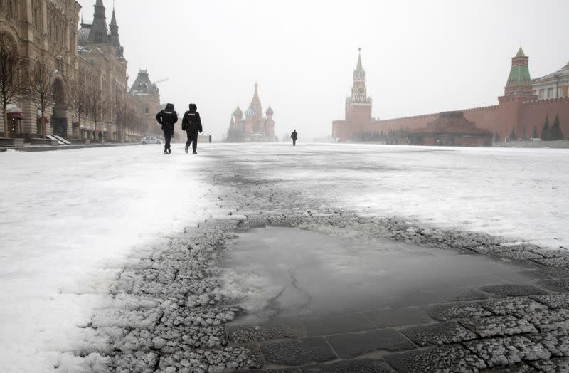 FILE PHOTO: Police officers patrol Red Square in Moscow