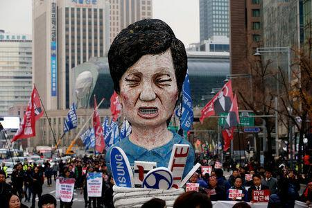 Members of Korean Confederation of Trade Unions march with an effigy of South Korean President Park Geun-hye during a general strike calling for Park to step down, in central Seoul, South Korea November 30, 2016. REUTERS/Kim Hong-Ji