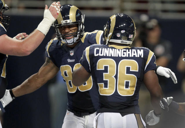 St. Louis Rams tight end Lance Kendricks, left, is congratulated by Benjamin Cunningham after scoring during in the second quarter of an NFL preseason football game against the Green Bay Packers Saturday, Aug. 16, 2014, in St. Louis. (AP Photo/Tom Gannam)