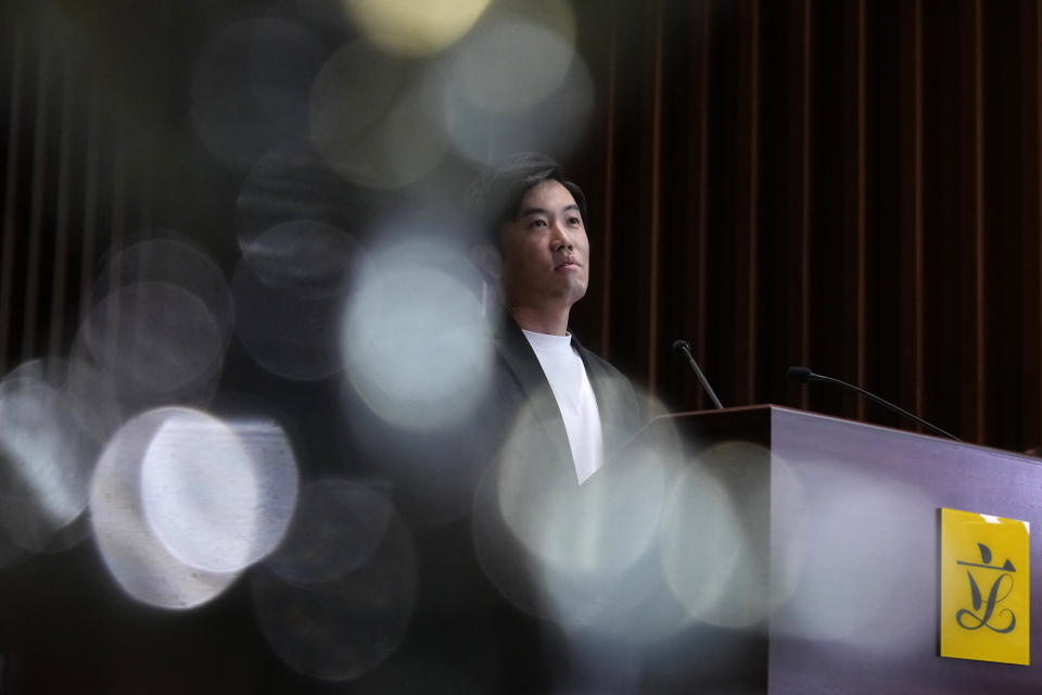 Lawmaker Cheng Chung-Tai pause during a press conference after being disqualified from the legislature in Hong Kong, Thursday, Aug. 26, 2021. Hong Kong authorities ousted Cheng from his seat Thursday after finding him to be insufficiently loyal amid Beijing's tightening grip on the semi-autonomous city. (AP Photo/Vincent Yu)